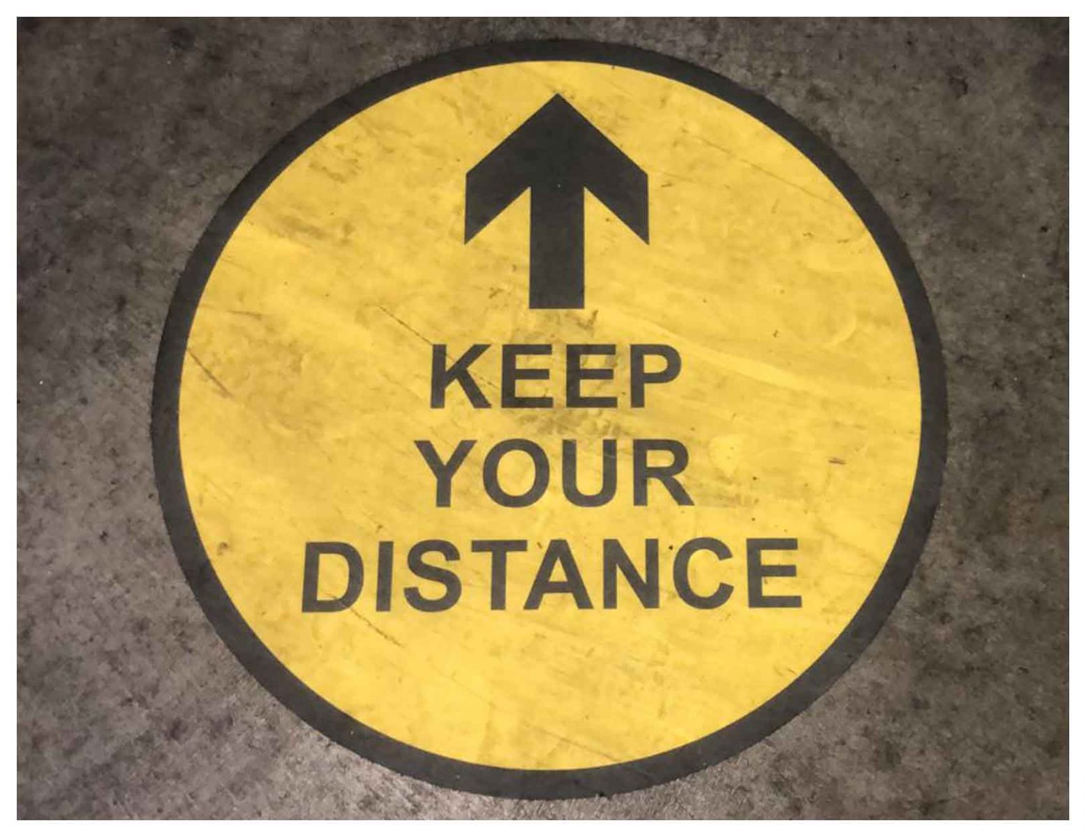keep your distance and one way floor sign